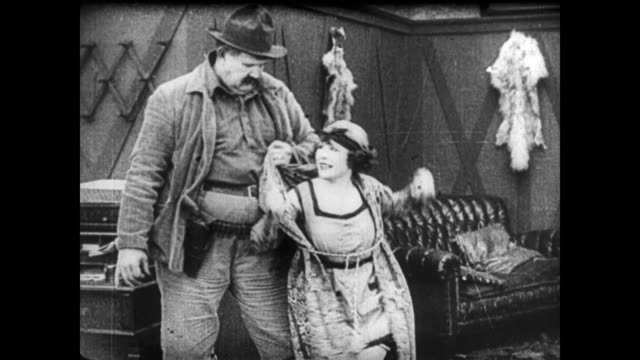 1921 woman (virginia fox) tries to stop a robbery and is harassed by lizard lip luke (joe roberts) - abuse stock videos and b-roll footage