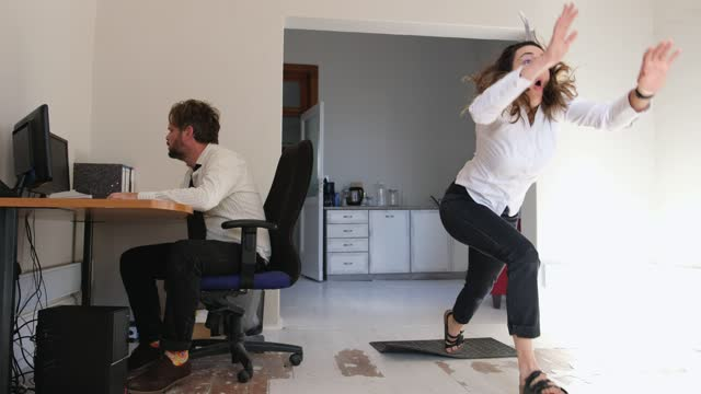 woman trips and falls in the office - blooper film clip stock videos & royalty-free footage