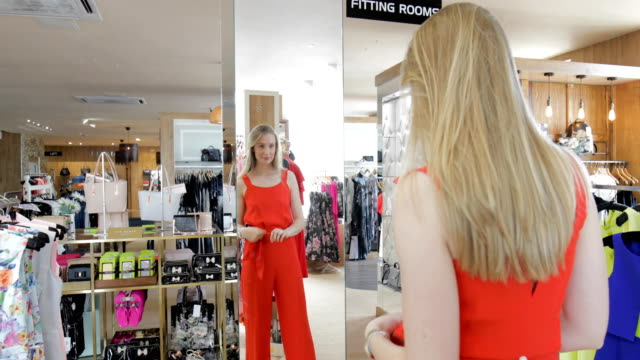 woman trying on clothes in the store - clothing stock videos & royalty-free footage