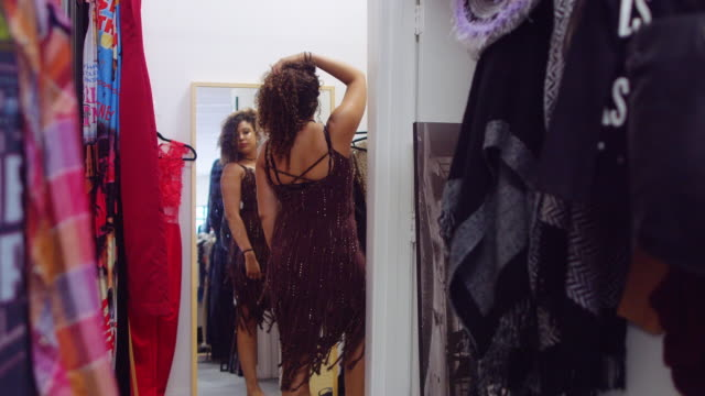 woman trying on clothes in vintage store - second hand stock videos & royalty-free footage
