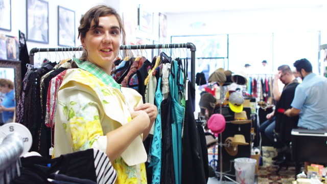 Woman Trying on Housecoat in Second Hand Store