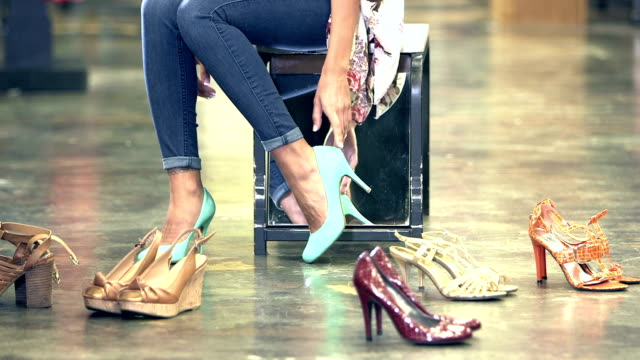 woman trying on shoes in store - jeans stock videos & royalty-free footage