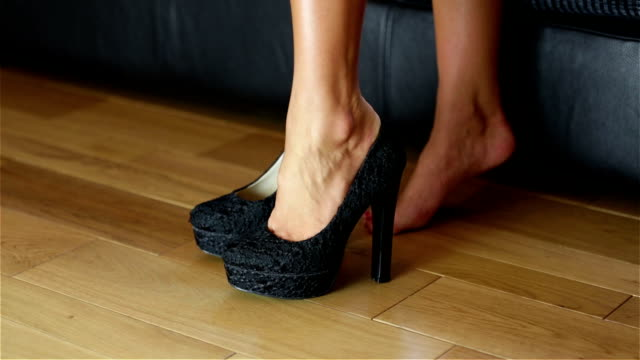 woman trying on stiletto shoes - human foot stock videos and b-roll footage