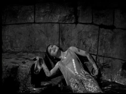 1925 cu b/w woman trying to get out form water in dungeon - trapped stock videos & royalty-free footage