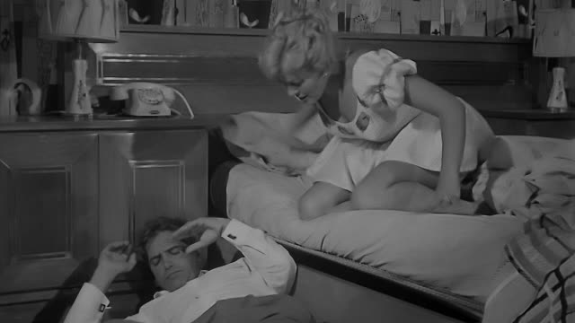 woman trying to wake up a man laying next to her bed not knowing why he is there. dramatization. - bed stock videos & royalty-free footage