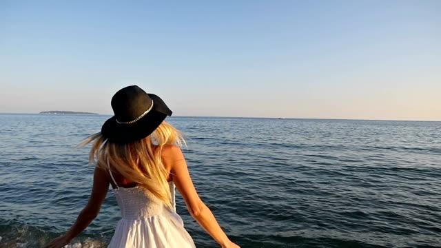 Woman turning along the Mediterranean sea