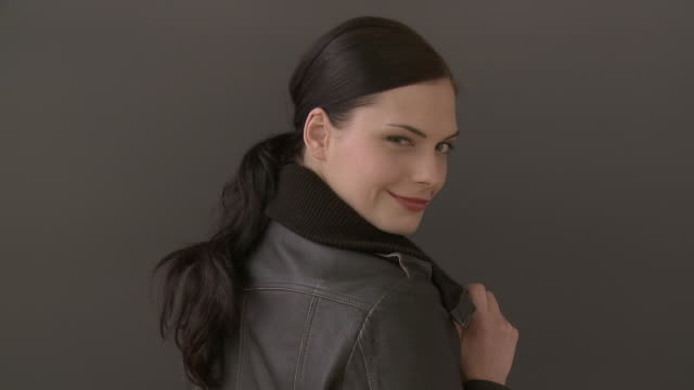 cu zi woman turning and winking while wearing leather jacket / berlin, germany - brown hair stock videos & royalty-free footage