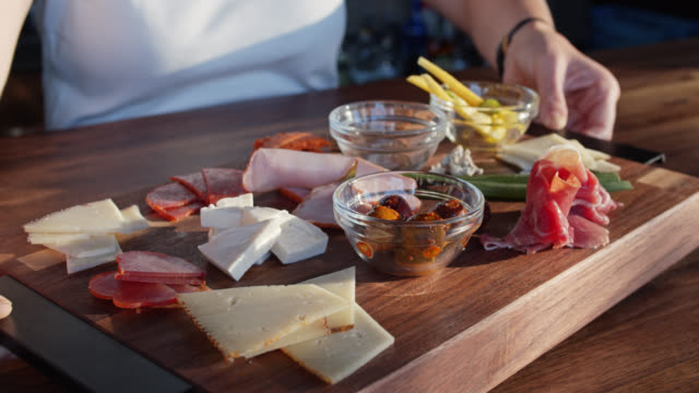 woman turning charcuterie plate - dining stock videos & royalty-free footage
