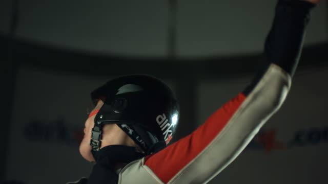 Woman turning in skydive simulator