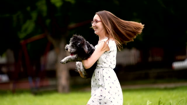Woman twirling with her dog