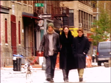 woman + two men walking dalmatian on greenwich village street / one man points / nyc - zeigen stock-videos und b-roll-filmmaterial