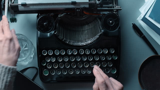 ld pov woman typing a letter on old typewriter. - typewriter stock videos & royalty-free footage