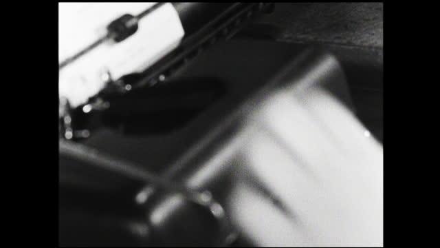 woman typing at typewriter and looking at various file cards - 1940 1949 bildbanksvideor och videomaterial från bakom kulisserna