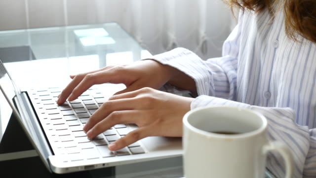woman typing laptop keyboard at home - author stock videos & royalty-free footage