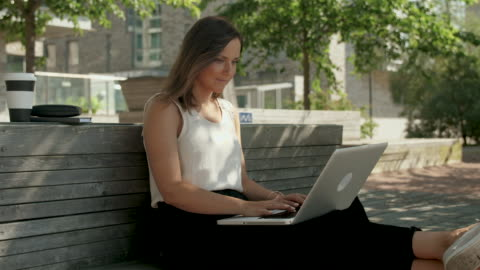 woman typing on a laptop - smart casual stock videos & royalty-free footage