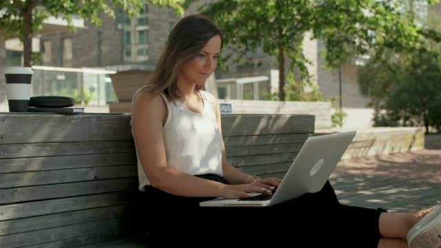 woman typing on a laptop - summer stock videos & royalty-free footage
