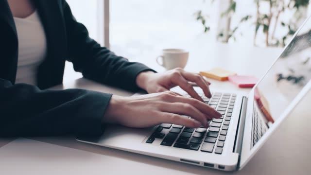 woman typing on computer - typewriter stock videos & royalty-free footage