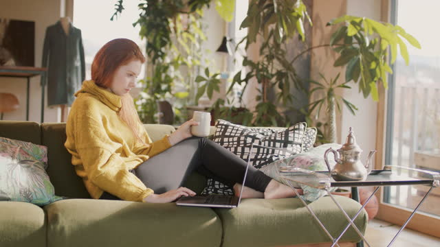 woman typing on laptop at home in sun - barefoot stock videos & royalty-free footage