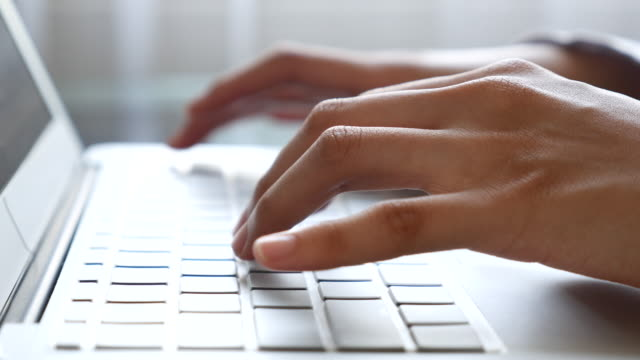 woman typing on laptop keyboard,close-up - computer key stock videos and b-roll footage