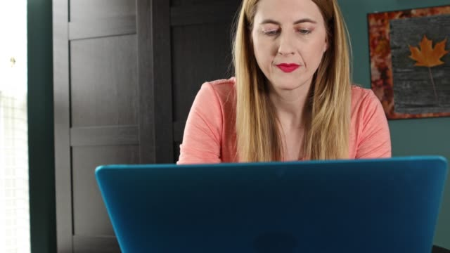 woman typing on laptop - only mature women stock videos and b-roll footage