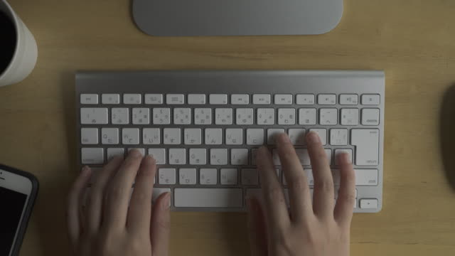 Woman typing the keyboard on table