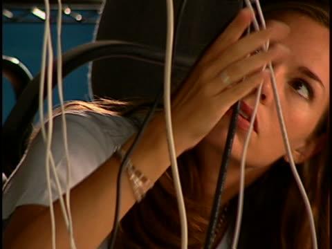 woman under computer desk - l'uomo e la macchina video stock e b–roll