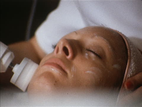 A woman undergoes a facial treatment at a beauty salon