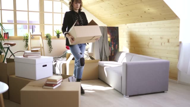 woman unpacking boxes in new home - tenant stock videos & royalty-free footage