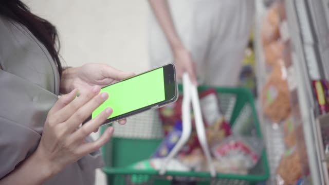 woman use a smart phone with green screen in department store. - mar stock videos & royalty-free footage