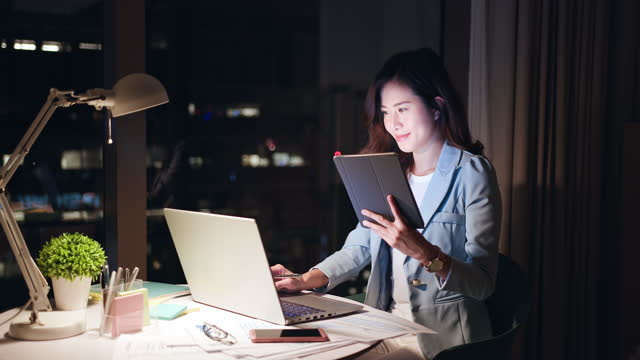 woman use laptop in office - remote control stock videos & royalty-free footage