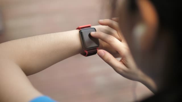 woman use of smart watch and smart phone - checking the time stock videos & royalty-free footage