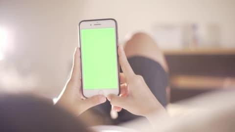 woman use smart phone chroma key 4k - green colour stock videos & royalty-free footage