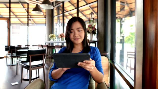Woman use tablet in the cafe