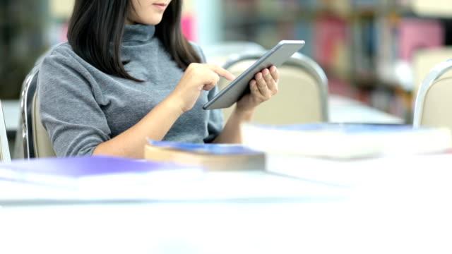 woman use tablet in the library - campus stock videos & royalty-free footage