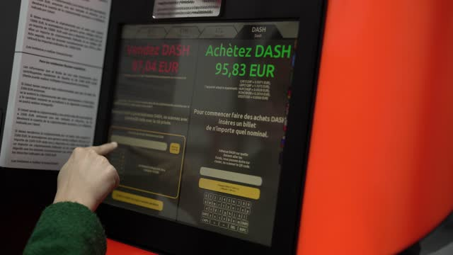 woman uses a bitcoin atm machine placed within a safety cage on january 29, 2021 in barcelona, spain. the european union agency for law enforcement... - blockchain stock videos & royalty-free footage