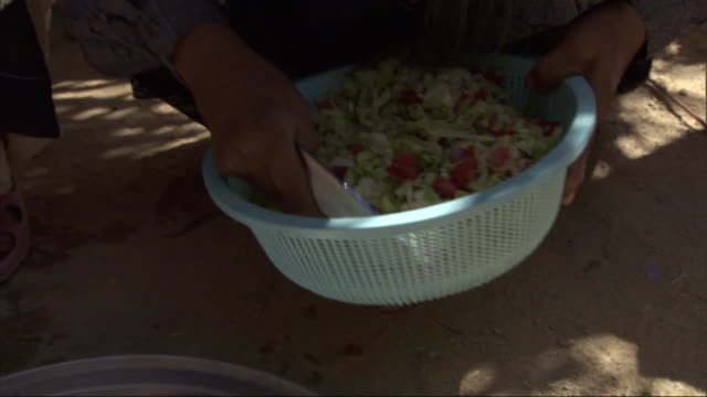 a woman uses a bowl to scoop salad onto serving plates. - serving scoop stock videos & royalty-free footage