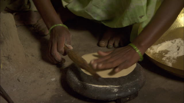 a woman uses a thin rolling pin to flatten dough. available in hd. - rolling pin stock videos & royalty-free footage
