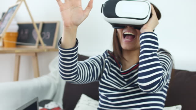 Woman uses a Virtual Reality Glasses at Home