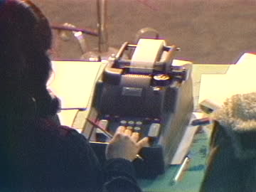 woman uses an adding machine to count ballots after the 1980 iranian presidential elections. - addierrolle stock-videos und b-roll-filmmaterial