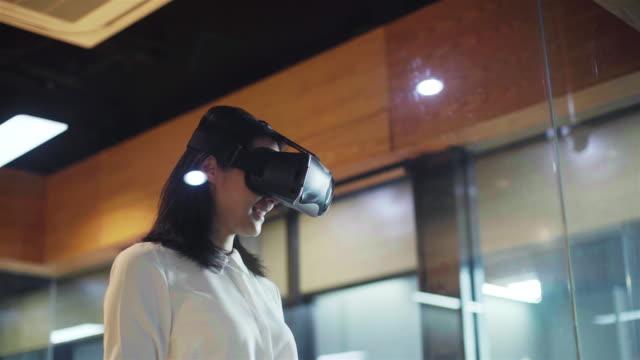 woman uses vr glasses in office - cyberspace stock videos & royalty-free footage