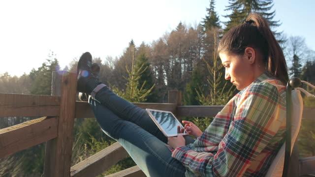 Woman using a digital tablet.