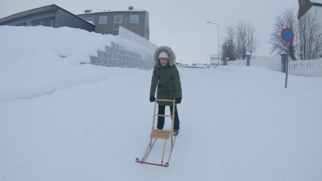 ws woman using a kick sled through the snow in kirkenes - only mid adult women stock videos & royalty-free footage