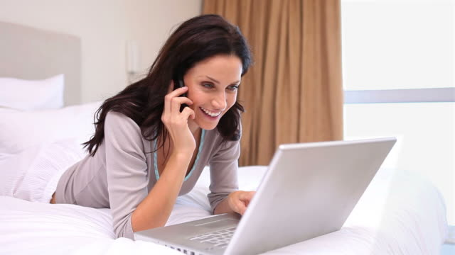 woman using a laptop - only mid adult women stock videos and b-roll footage