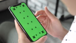 Woman Using a Phone with a Green Screen