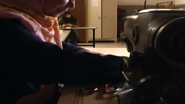 woman using a sewing machine at the vocational training of the mabarrat charity association that helps underprivileged children and young adults. - shi'ite islam stock videos & royalty-free footage