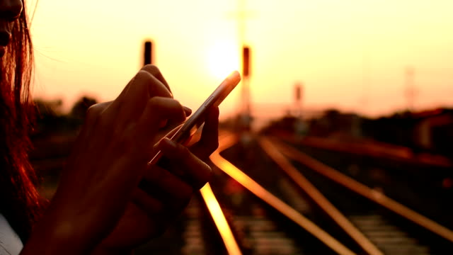 woman using a smartphone on the railway. - portability stock videos & royalty-free footage
