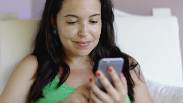 ms woman using a smartphone / porto seguro, brazil - porto seguro stock videos & royalty-free footage