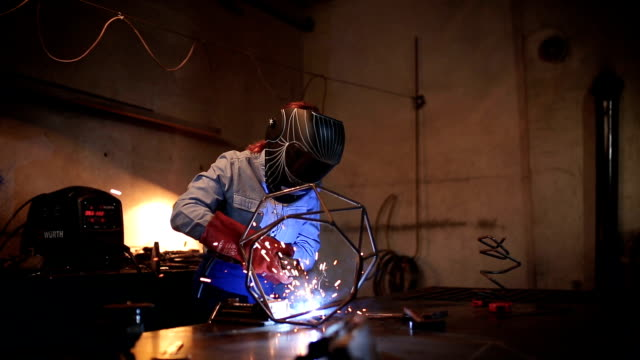 woman using a welding machine - sculpture stock videos & royalty-free footage