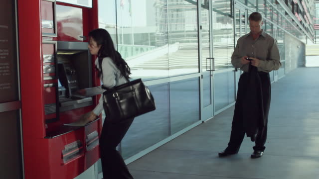 ms woman using atm, man waiting in line, los angeles, california, usa - 50 54 jahre stock-videos und b-roll-filmmaterial