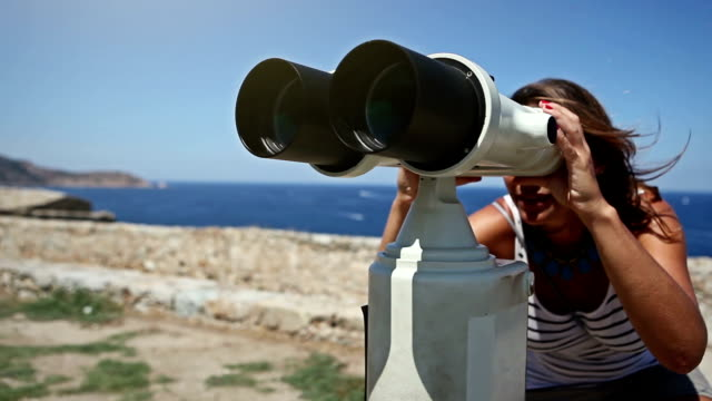 woman using binoculars - binoculars stock videos & royalty-free footage